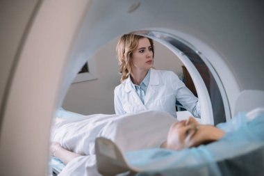 selective focus of attentive radiologist operating mri machine during patients diagnostics
