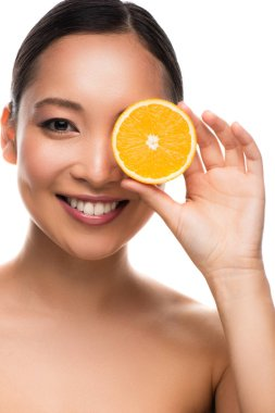 Attractive asian woman holding orange, isolated on white stock vector