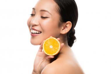 Beautiful smiling asian woman holding orange, isolated on white stock vector