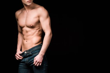 cropped view of muscular and shirtless man standing isolated on black
