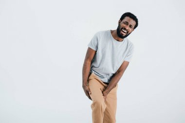 Beard african american man having pain in leg isolated on grey stock vector