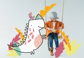 Photo cute kid in jeans and orange shirt sitting on swing and reading book on grey background with fantasy bird and dinosaur illustration