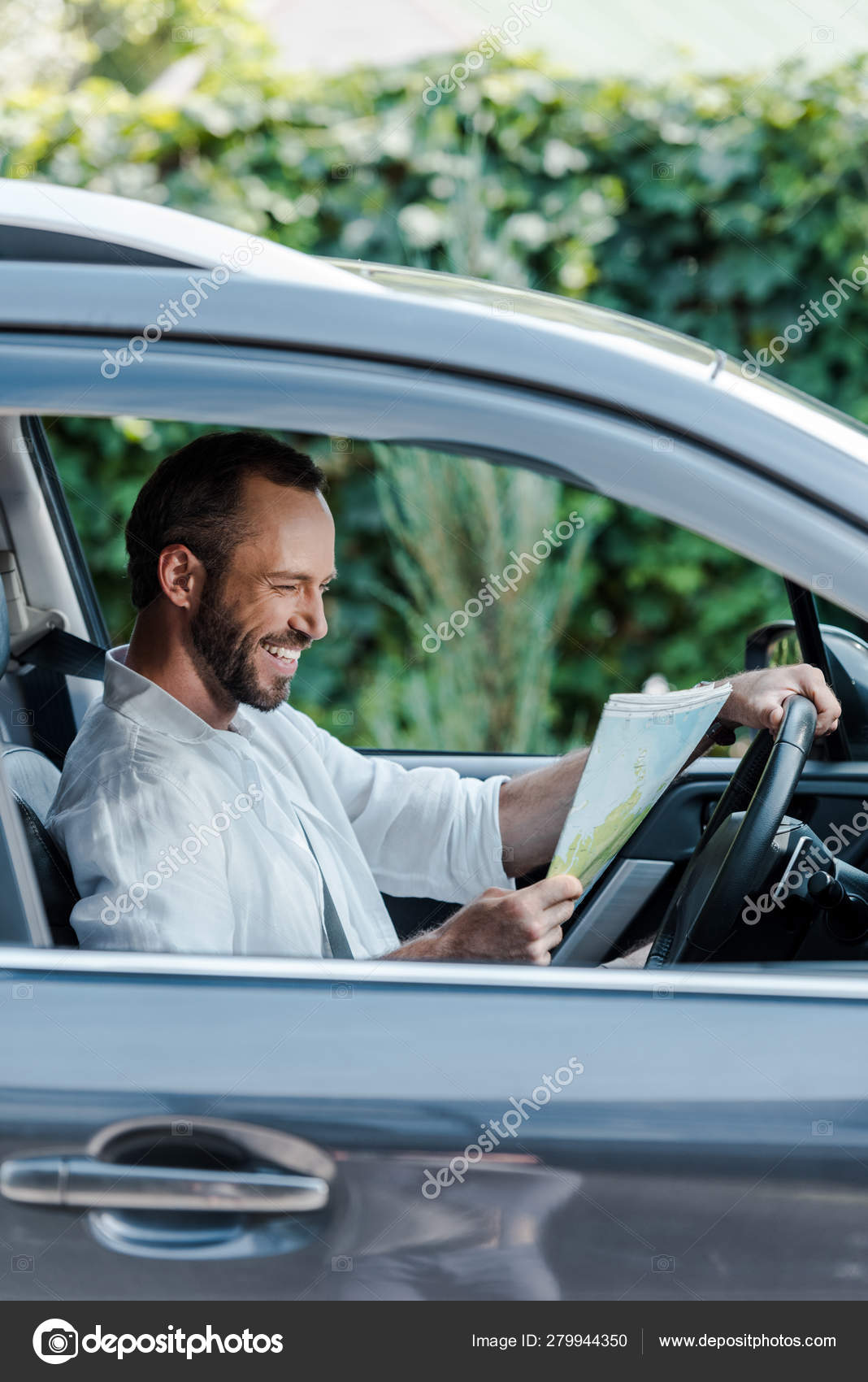 Selective Focus Happy Driver Sitting Car Looking Map — Stock ... on navigation in car, water in car, time in car, entertainment in car,