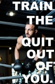 Photo handsome athletic man in boxing gloves standing near ropes in boxing ring with train the quit out of you illustration