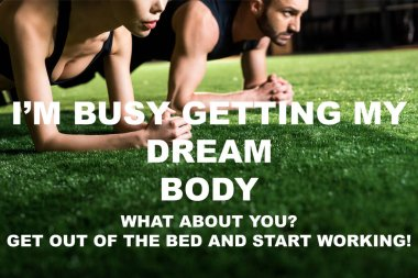 cropped view of woman doing plank exercise with handsome man on grass with i am busy getting my dream body illustration