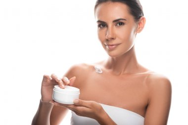 Attractive young woman holding cosmetic cream isolated on white stock vector