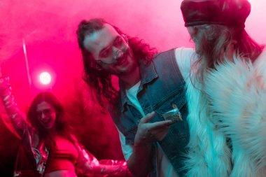 Happy man giving weed in plastic zipper bag to girl in nightclub stock vector