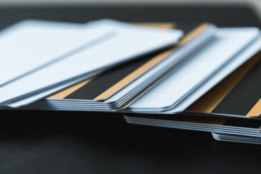 selective focus of stack with credit cards on black