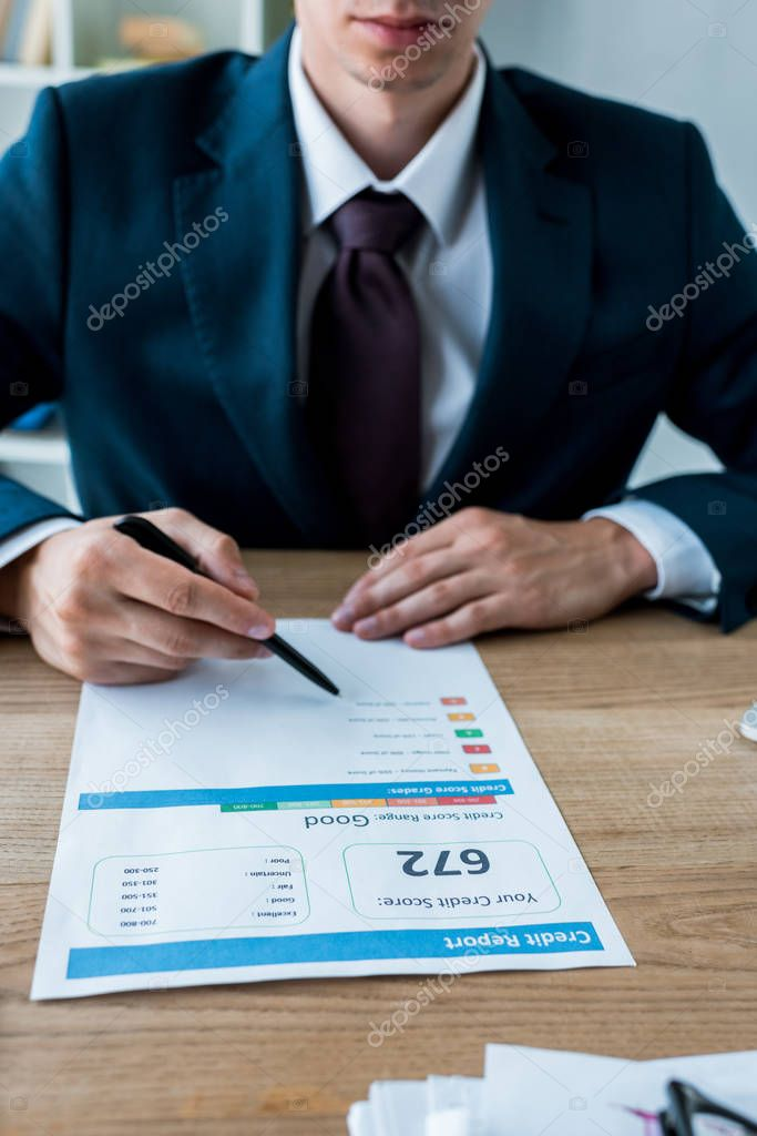 Cropped view of businessman in suit holding pen near document with letters stock vector