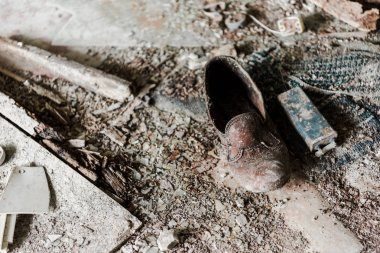abandoned and dirty shoe on floor in chernobyl