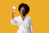 Photo attractive african american woman with duck face taking selfie isolated on orange