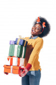 cheerful african american girl in deer horns holding christmas gifts, isolated on white