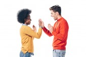beautiful multicultural couple in winter clothes giving highfive, isolated on white