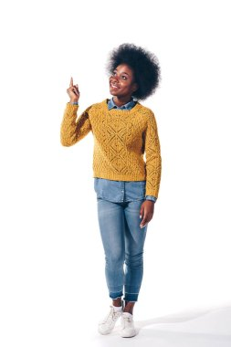 Smiling african american girl in yellow sweater pointing up, isolated on white stock vector