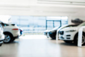 blurred car showroom with new and luxury cars