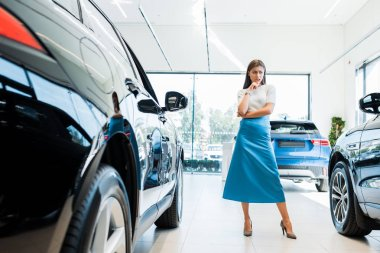 Selective focus of pensive woman standing near cars stock vector