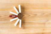 top view of wooden rectangles with lettering seo on table