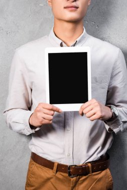Cropped view of seo manager holding digital tablet with copy space stock vector