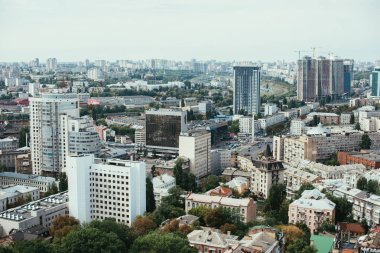 aerial view of urban city with buildings and streets