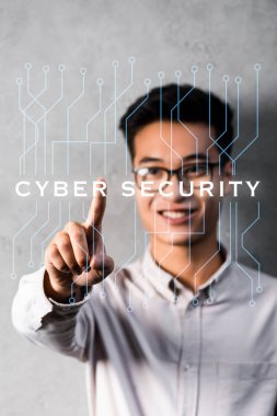 Selective focus of asian businessman touching illustration with cyber security lettering stock vector