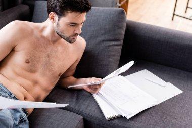 Shirtless male freelancer doing paperwork on sofa during quarantine stock vector