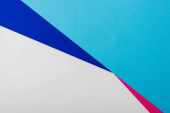elvont geometriai háttér fehér, rózsaszín, kék papír