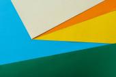 abstraktní geometrické pozadí s barevným světlým papírem