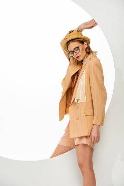 Beautiful stylish girl standing near round hole on white background stock vector