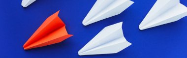 Top view of white and red paper planes on blue background, leadership concept, panoramic shot stock vector