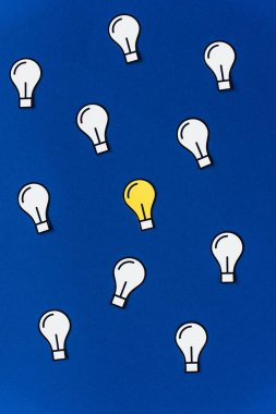 Top view of paper light bulbs on blue background, business concept stock vector