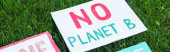 Panoramic shot of placard with no plant b lettering on grass outdoors, ecology concept