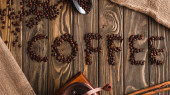 top view of coffee lettering made of beans on wooden surface