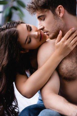 Brunette woman touching muscular and seductive boyfriend stock vector