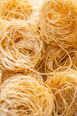 Close up view of raw Italian Capellini with flour stock vector