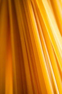 Close up view of uncooked Italian spaghetti stock vector