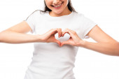 Fotografie cropped view of young woman showing heart sign with hands isolated on white