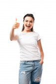 young woman in white t-shirt and jeans standing with hand in pocket and showing thumb up isolated on white