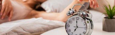 Website header of woman touching retro alarm clock stock vector