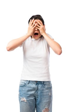 scared young woman in white t-shirt covering face isolated on white