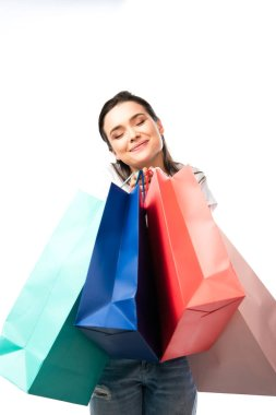 Young brunette woman with closed eyes holding shopping bags isolated on white stock vector
