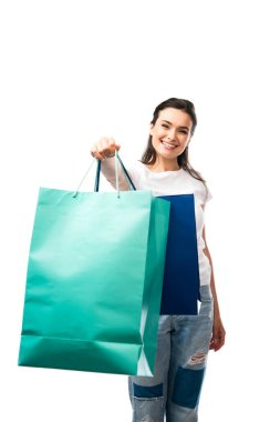 Selective focus of young brunette woman holding shopping bags isolated on white stock vector