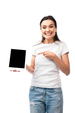Young woman in white t-shirt pointing with finger at digital tablet with blank screen isolated on white stock vector