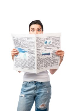 Shocked brunette woman in white t-shirt covering face with newspaper isolated on white stock vector
