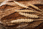 close up view of fresh baked bread with spikelets