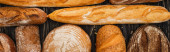 top view of fresh baked bread loaves, panoramic shot