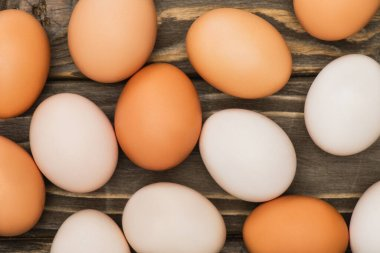 Top view of fresh chicken eggs on wooden surface stock vector
