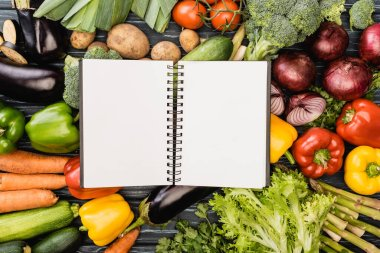 Top view of fresh colorful vegetables around empty notebook stock vector