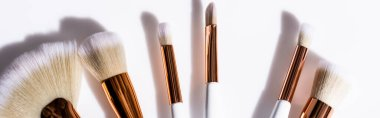 Top view of cosmetic brushes set on white background, panoramic shot stock vector