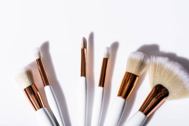 Top view of cosmetic brushes set on white background stock vector