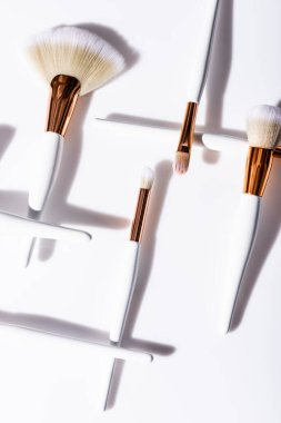 Flat lay with cosmetic brushes set on white background stock vector